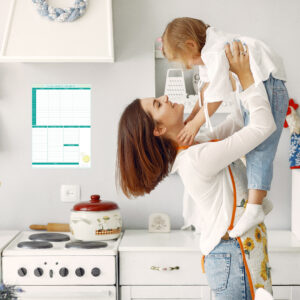 Cute little son with mother. Family at home in a kitchen.